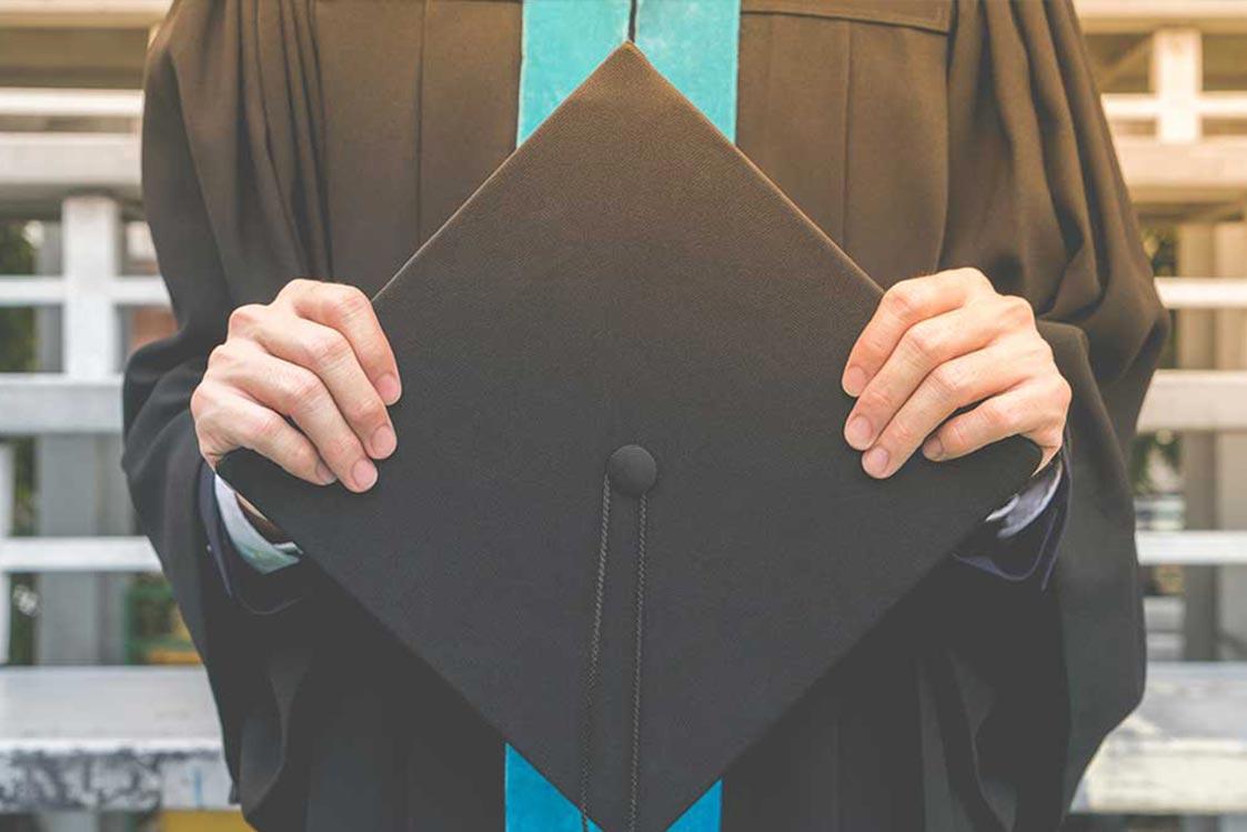 Student holding graduation cap
